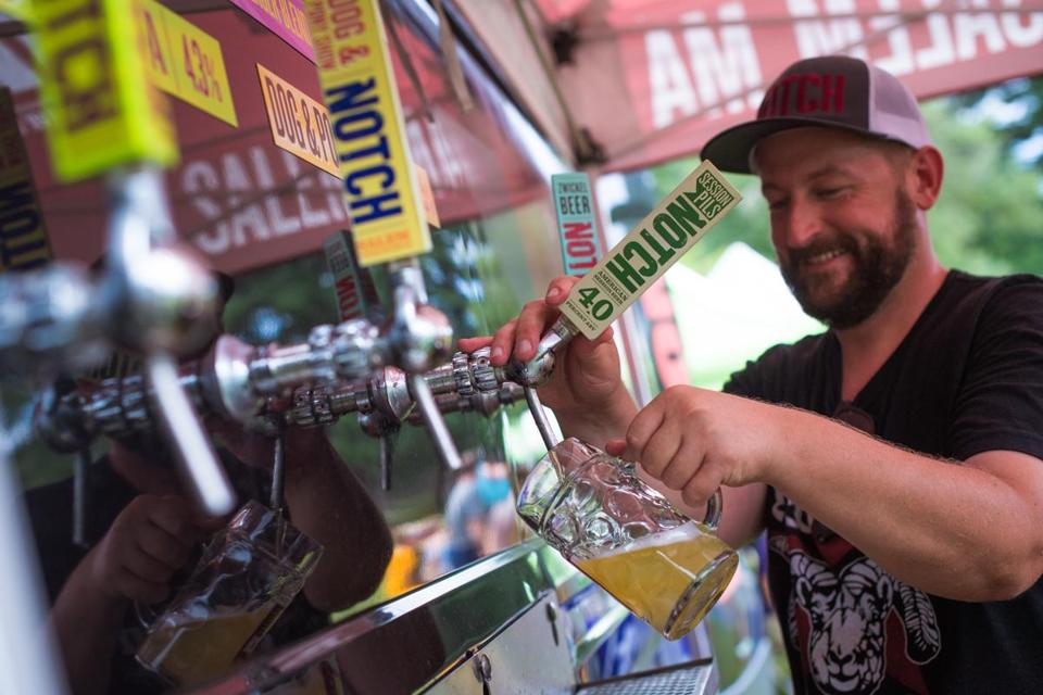JT Thompson, Notch's event coordinator, poured a beer for a visitor to the Notch Traveling Biergarten in Bird Park in Walpole.